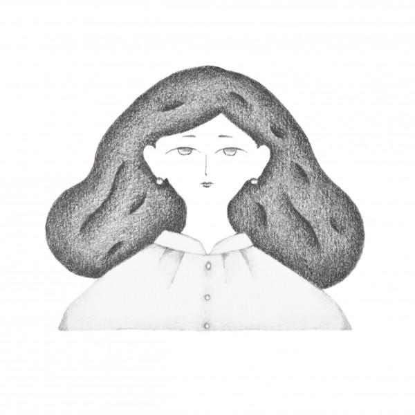 白いブラウスを着た女性のポートレート