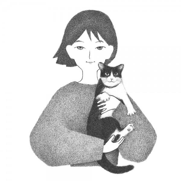 愛猫を抱く男性のポートレート